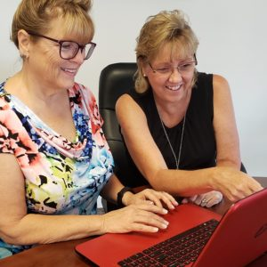 Safeguard Your Memories™ with Melody helping a client on the computer