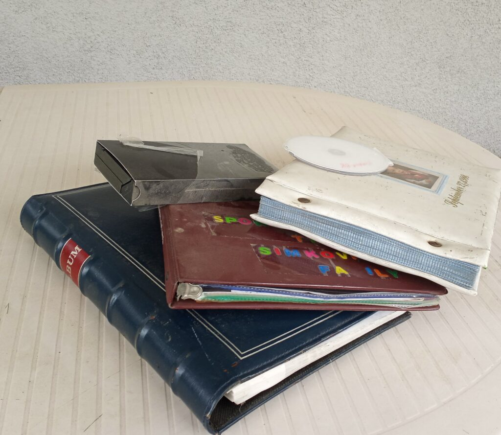 Photo albums, vhs tape and CD in a stack