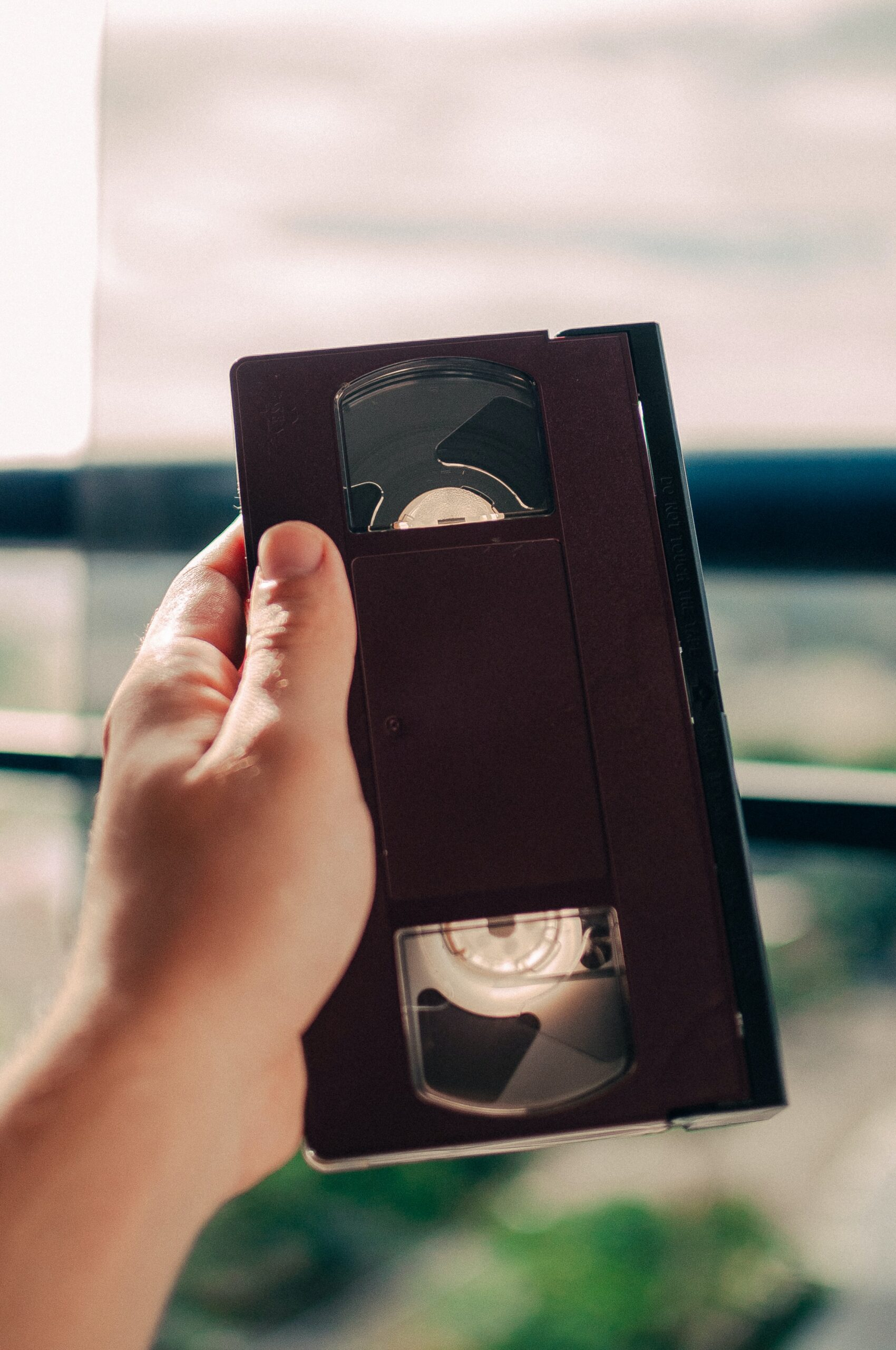 Person holding a VHS tape