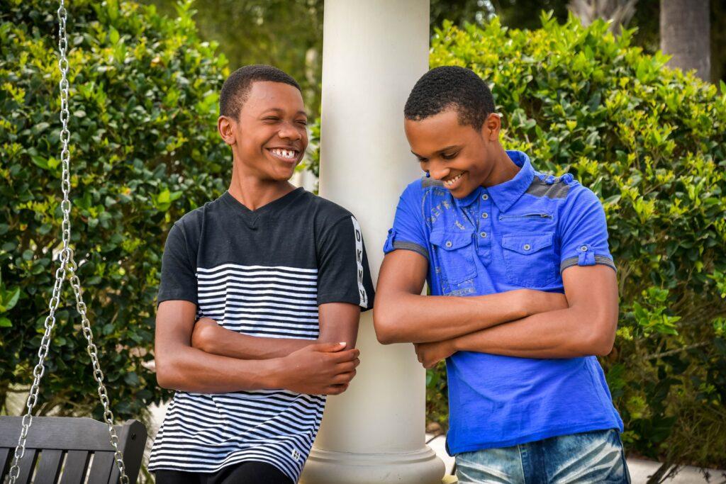 2 teen boys smiling