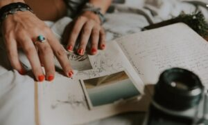 Woman's fingers on journal with picture