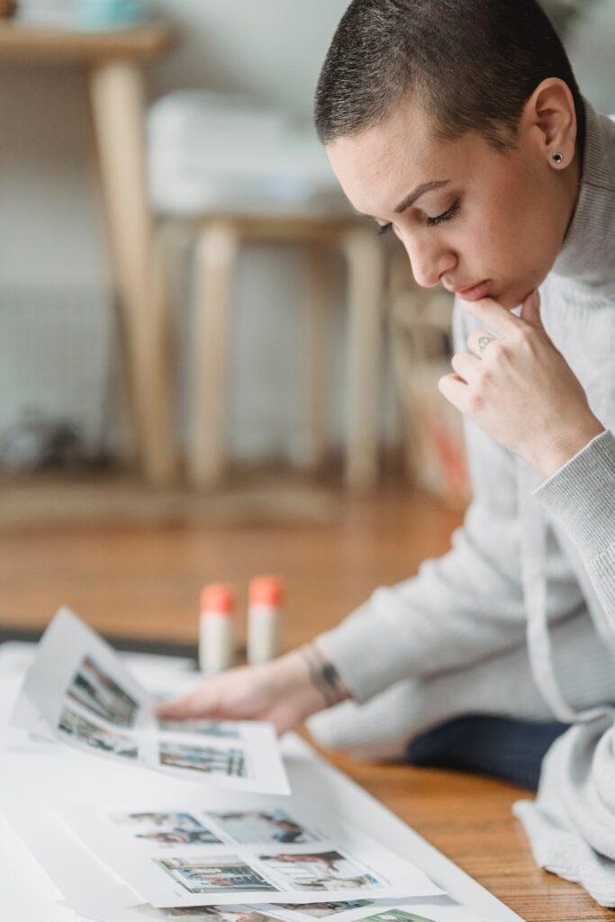 Woman looking at printed photos